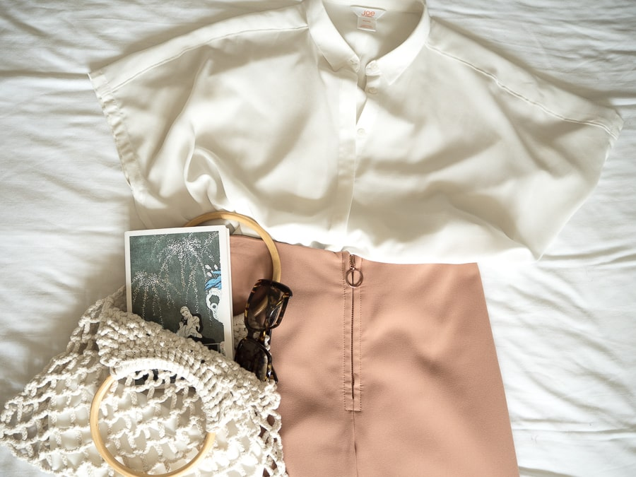 outfit flatlay woven bag